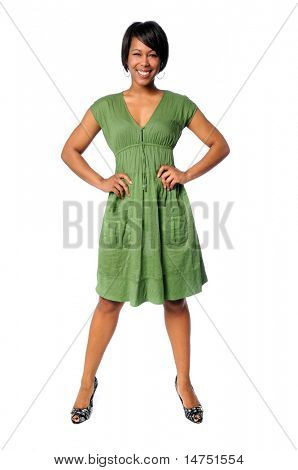 Beautiful African American woman standing with hands on hips isolated over white background