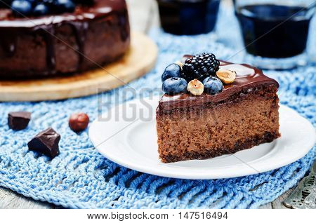 Chocolate hazelnut cake cheesecake on wood background