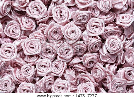 background of artificial flowers bulk on a table. close-up