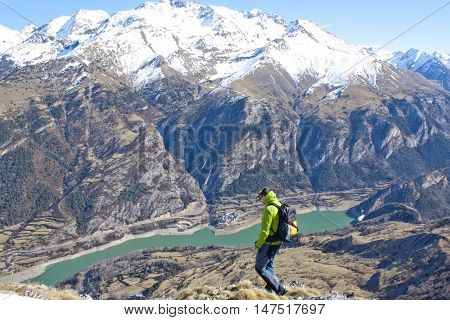 mountaineer going down of a mountain walking