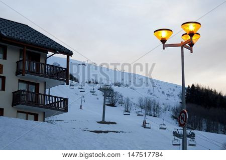 house and a lamppost in a ski