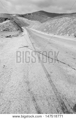 In Oman Asphalt Street White Line And Mountain Panorama