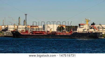 Sarnia, Ontario, Canada - September 12, 2016: The Great Lakes freighter Algonova at the Esso refinery in Sarnia, Ontario. Operating under Imperial Oil, it is the largest producer of petroleum products in Canada.