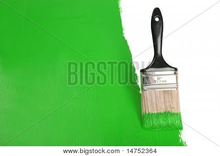Brush painting wall with green paint