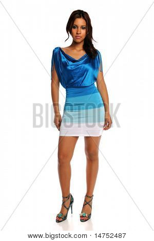 Portrait of beautiful Latino woman in blue dress and high heels isolated over white