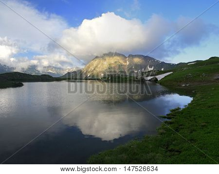 landscape lake in mountains summer day. reflected in upper waterton lake