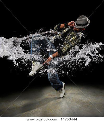 African American dancer dancing with water splash over dark background