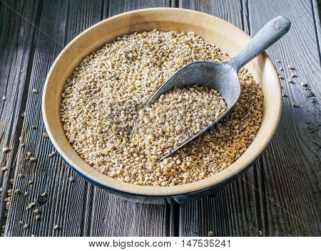 Raw Organic Steel Cut Oats in a Bowl on Wood Background. Selective Focus, Toning.