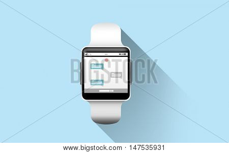 modern technology, online communication, object and media concept - close up of black smart watch with messenger application on screen over blue background