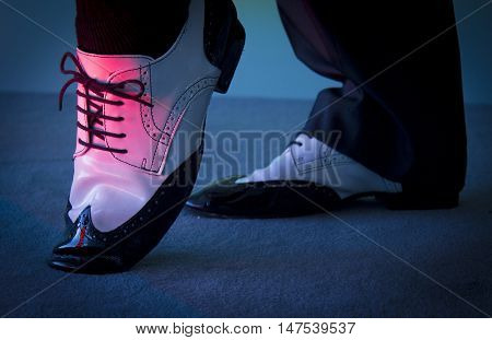 Dancing shoes feet of male ballroom latin salsa and swing dancer