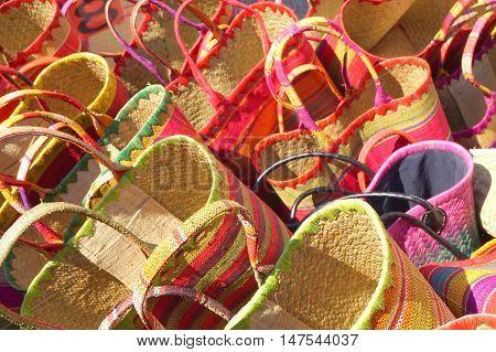 Bright Colored Wicker Raffia Baskets On A Sunny Market Stall