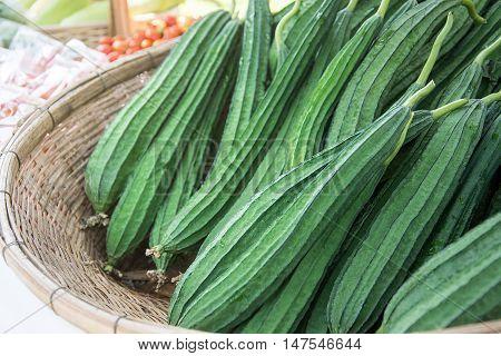 Fresh Angled loofah Angled Gourd (Luffa acutangula Roxb.) fruits in basket