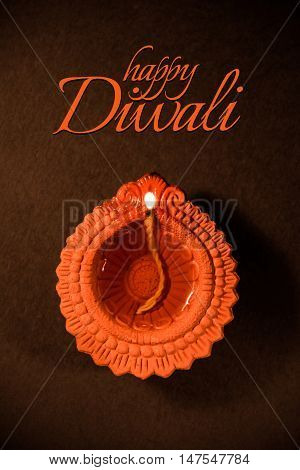 happy diwali or happy deepavali greeting card made using a photograph of diya or oil lamp