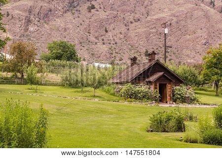 Photo of dreamy rural house at summer day