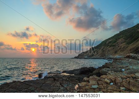 Rocky coastline during sunset at Rayong province Thailand.