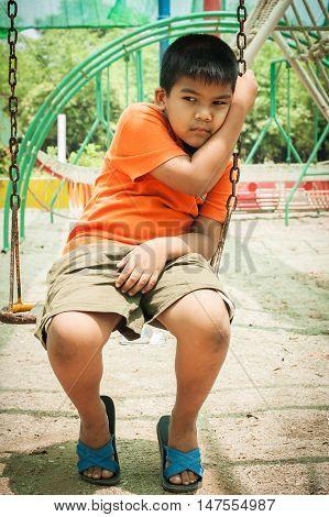 asian child little boy sad alone at playground
