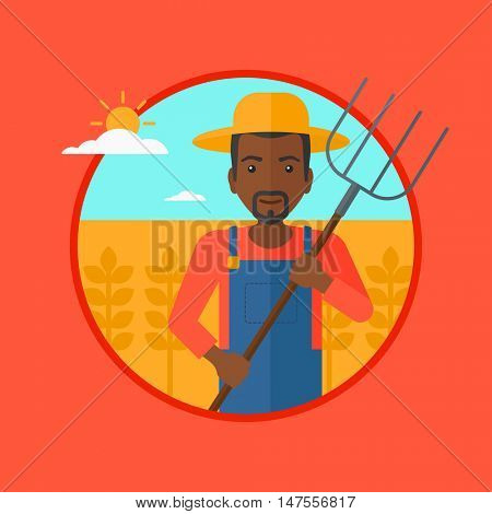 An african-american farmer standing with a pitchfork in wheat field. Man holding agricultural tool and working in wheat field. Vector flat design illustration in the circle isolated on background.