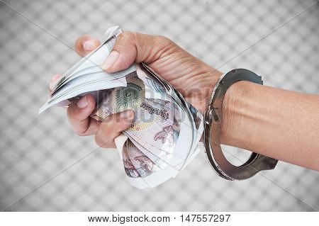 Slave Human Trafficking concept ,hand in cuff hold money
