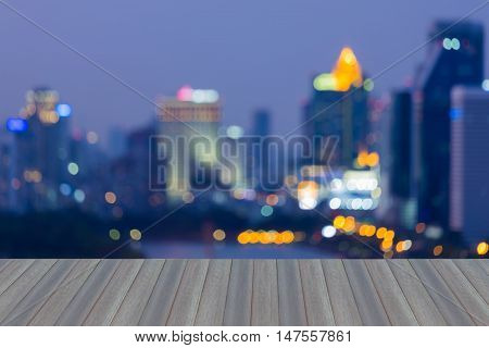 Open wooden floor, Twilight blurred lights night view office building abstract background