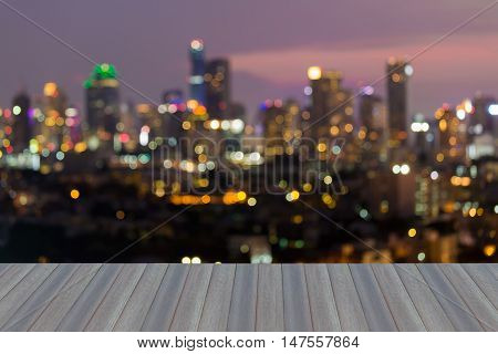 Open wooden floor, City office building lights abstract background, Bangkok Thailand