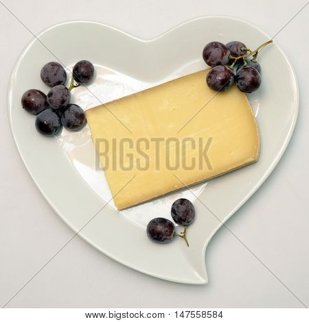 Heart Shaped Plate With French Cheese And Grapes