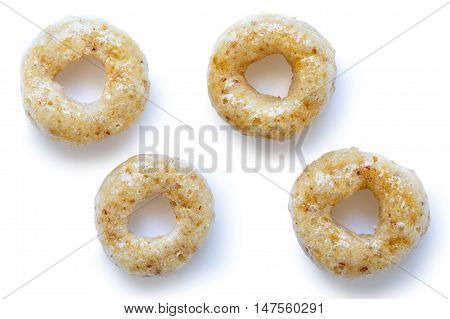 Collection Of Four Honey Cheerios Isolated On White From Above.