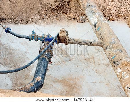 Excavation Pit. Old 500Mm Drink Water Pipe With 150Mm  Cornering Arm With Gate Valves, Corroded  Joi