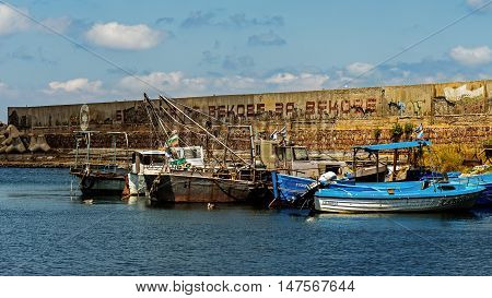 SOZOPOL, BULGARIA - JULY 16, 2016: Fishing boats moored in the port of Sozopol, one of the oldest Bulgarian towns founded in the 7th century BC, one of the major seaside resorts in the country.