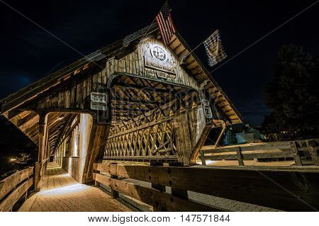 Frankenmuth Wooden Covered Bridge.  Covered bridge in the town of Frankemuth, Michigan. The local landmark spans the Cass River and is open to auto traffic.