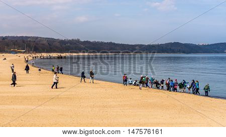 SOPOT, POLAND - APRIL 09, 2016: Beach scenes from Sopot, a major health-spa and tourist resort on the Polish Baltic Sea coast dating back to 1823, famous of the longest wooden pier in Europe.