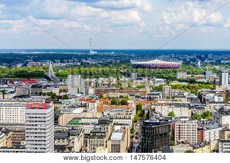 WARSAW, POLAND - MAY 3, 2016: City panorama with The National Stadium designed for UEFA EURO 2012 with its advanced infrastructure remains one of the most modern sport facility in Europe.
