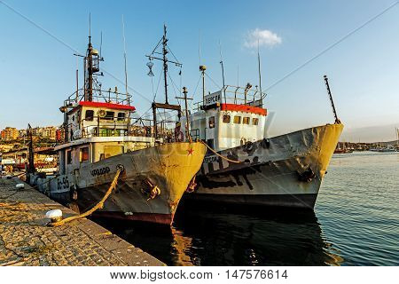 SOZOPOL, BULGARIA - JULY 17, 2016: Cutters moored in the port of Sozopol, one of the oldest Bulgarian towns founded in the 7th century BC, nowadays one of the major seaside resorts in the country.