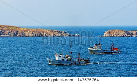 SOZOPOL, BULGARIA - JULY 29, 2016: Cutters return from fishery in Sozopol, one of the oldest Bulgarian towns founded in the 7th century BC, nowadays one of the major seaside resorts in the country.