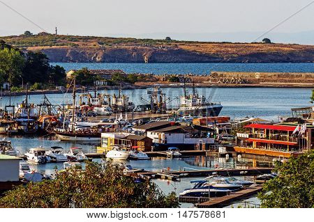 SOZOPOL, BULGARIA - JULY 24, 2016: Overall vie of the harbor in Sozopol, one of the oldest Bulgarian towns founded in the 7th century BC, nowadays one of the major seaside resorts in the country.