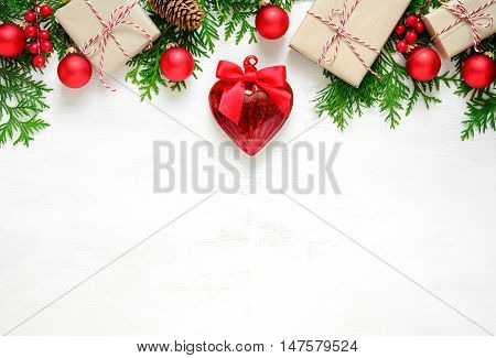Xmas or New Year background holiday plain composition made of Christmas decorations and fir twigs on a wooden background flat lay view from above