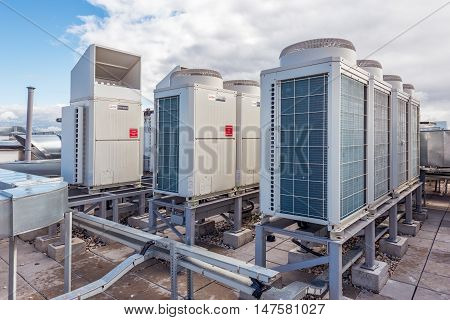 Moscow Russian Federation September 14 2016: Air conditioning system for Mitsubishi assembled and installed on top of a building.