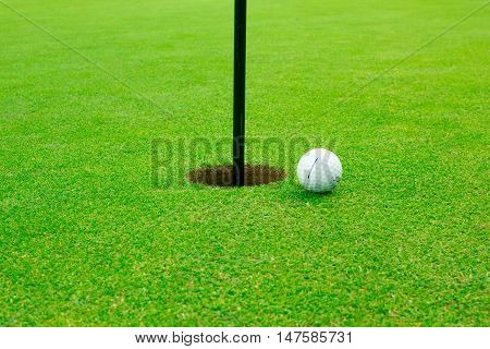 Gothenburg, Sweden - September 17, 2016: A titleist golfball laying on green, close to the hole