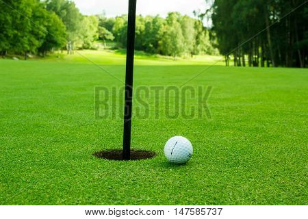 Gothenburg, Sweden - September 17, 2016: A titleist golfball laying on greeen, close to the hole