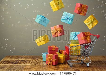 Christmas holiday sale concept with shopping cart and gift boxes