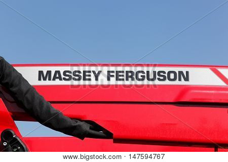Odder, Denmark - September 13, 2016: Massey Ferguson logo on a tractor. Massey Ferguson is an American-owned major manufacturer of agricultural equipment