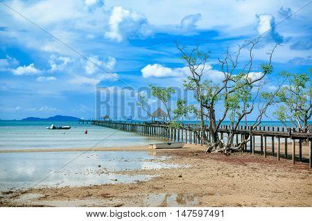 Wooden pier in beautiful beach kho Mak Island eastern Thailand.