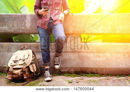 Front portrait of a young man traveler He is using mobile phone travel concept