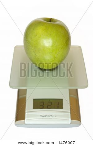 Big Green Apple On Electronic Kitchen Scales
