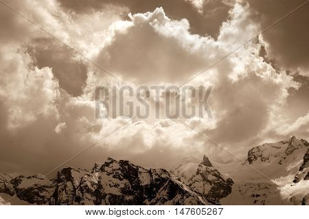 Winter Mountain In Sunlight Clouds