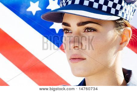 american female police officer portrait, background is US flag