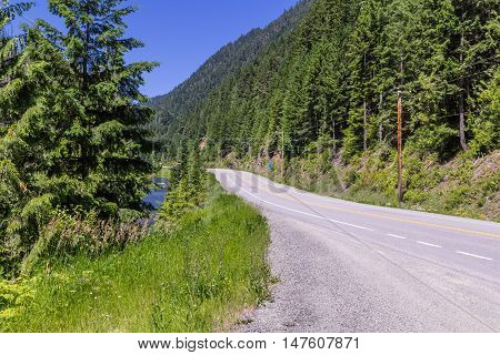 Rural road along river on summer day