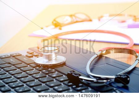 Stethoscope on laptop keyboard and  light Fair