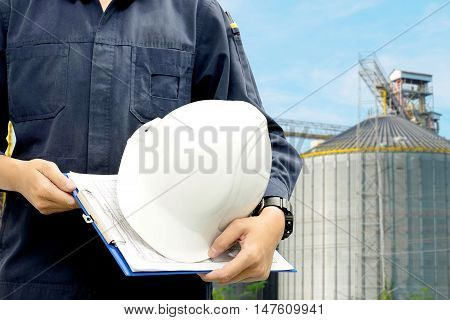 Exposure engineer The background is industrial of power plant