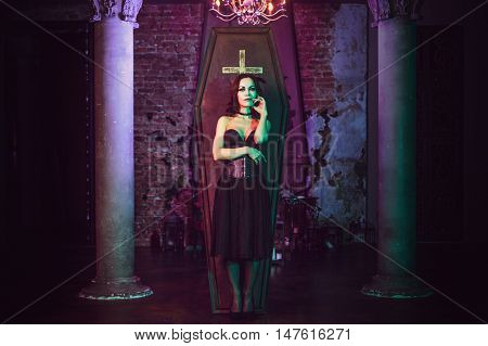 Beautiful and sexy vampire in her mansion. Halloween costume