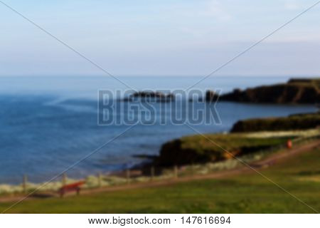 Cornish Coastline Viewed From The Cliff In Bude Out Of Focus.
